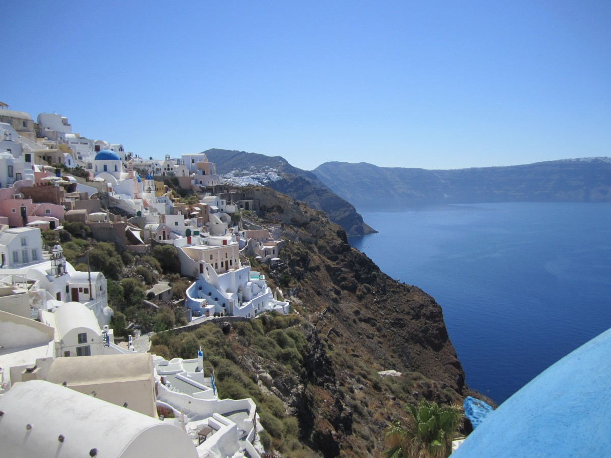 The majestic and unique Santorini Island, boasts a quaint village atmosphere atop steep volcanic cliffs.